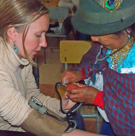 Student and woman working with stethoscope